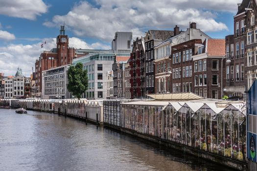 Row of glasshouses on Singel Canal in Amsterdam, the Netherlands