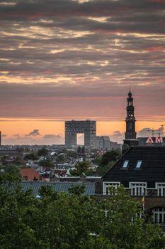 Daybreak skies with Pontsteiger and Westerkerk over Amsterdam, t