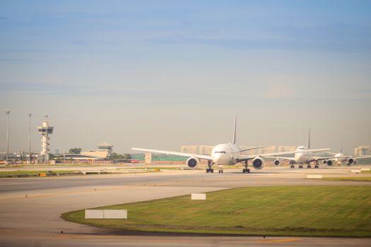 Thai airways airplane is taxiing on runway before taking-off at Suvarnabhumi international airport.