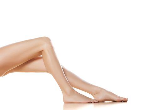 pretty female legs on white