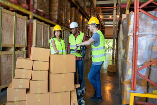 Portrait of warehouse team discuss about work in a warehouse.