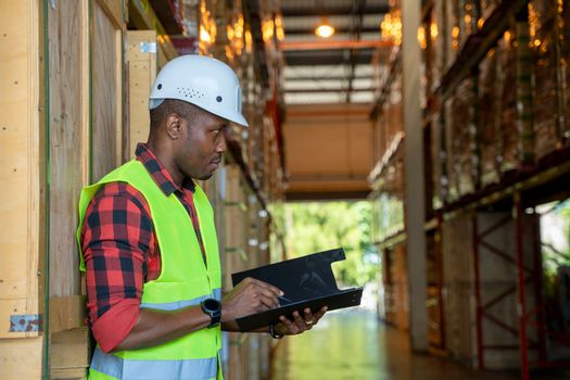 Portrait warehouse workers holding a clipboard working in a warehouse.