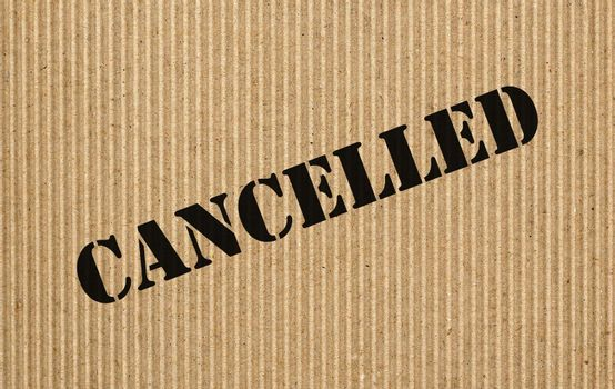 Cancelled label written on brown corrugated cardboard