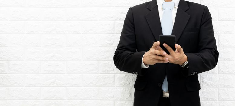 Business men hold smartphones to check information at the office