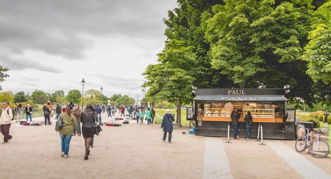 Paris, France - May 08, 2017 : In the garden of the Tuileries, in Paris, tourists buy food at Paul, a chain of shops very well known for their sandwitch