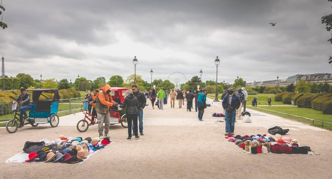Paris, France - May 08, 2017 : In the garden of the Tuileries, in Paris, tourists buy souvenirs from street vendors