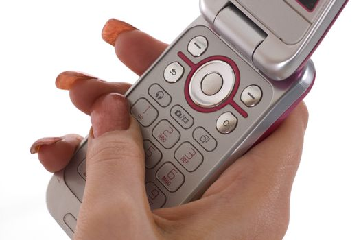 A female hand texting on a mobile phone
