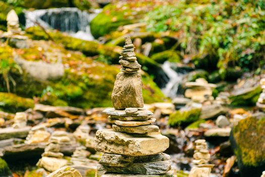 Balancing rock pile in zen style, typical of buddhist meditation, erected near a torrent in Nepal