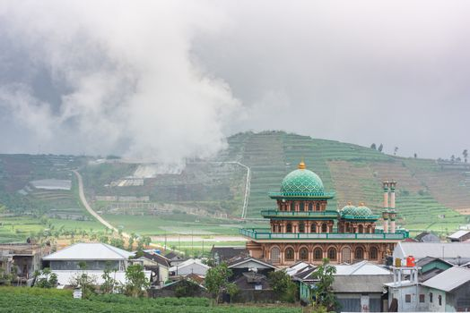 Mosque and sulphur fumes in Dieng Plateau, Central Java, Indones