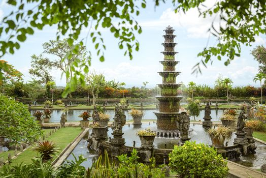 Tirtagangga royal gardens, Bali, Indonesia, with tiered fountain, fish ponds and stone causeway through pools