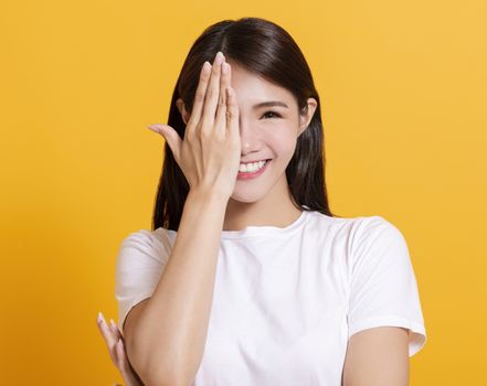 smiling young woman hand cover eye