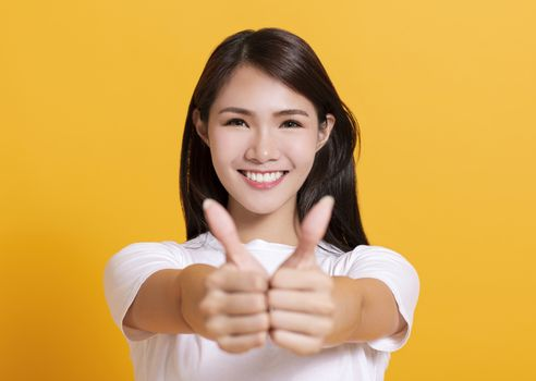 smiling young woman hand showing thumbs up