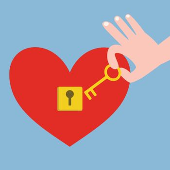 Hand holding golden key with red heart with keyhole on blue background