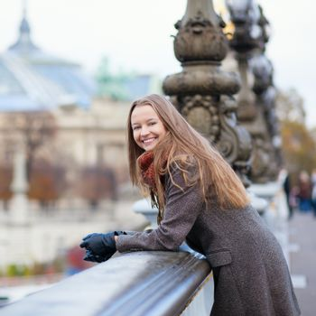 Happy positive girl on the Pont Alexandre III in Paris