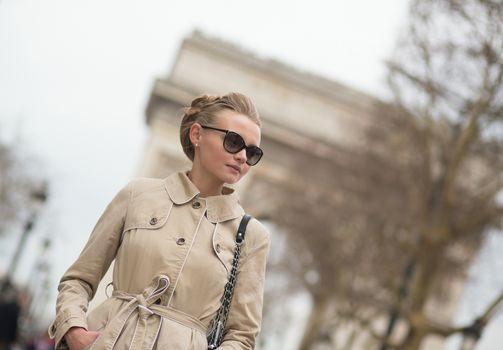 Elegant Parisian woman on Champs-Elysees