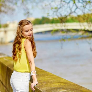 Beautiful young girl walking in Paris on a sunny summer or spring day