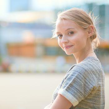 Girl walking at La Defense, business district of Paris