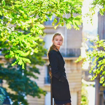 Beautiful young girl in Paris on a fall day