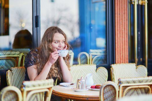 Beautiful Parisian woman in cafe