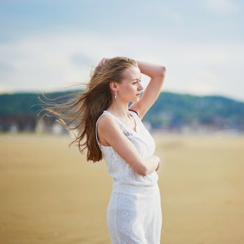 Beautiful young woman enjoying her vacation by ocean or sea. People on sea vacation concept