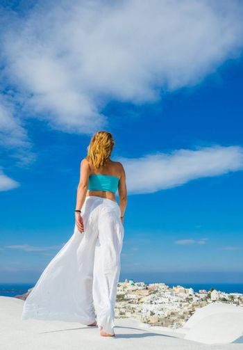 WOman on the rooftop in Santorini island Greece