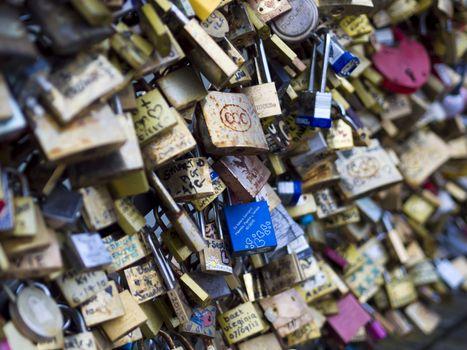 PARIS - DEC 6: Love Padlocks at Pont de l'Archevche on December 6, 2013, in Paris. The thousands of locks of loving couples symbolize love forever.