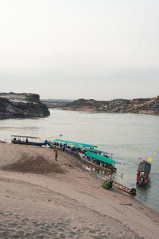 Longtail boat, Berth at sand Sam Pan Bok Grand Canyon in Maekhong river, Northeast of Thailand.