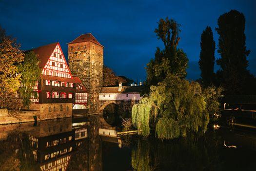 Nuremberg city houses on riverside of Pegnitz river from Maxbrucke (Max bridge). Nuremberg, Franconia, Bavaria, Germany
