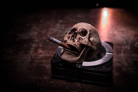 No smoking concept. Creative artwork table decoration with cigarettes. Cigarettes cause cancer and kill.