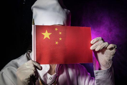Woman doctor in mask holding Chinese flag. Fear of illness, corona virus 2019-2020. Virus, outbreak and mass disease, Corona virus concept.