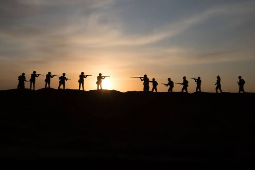 War Concept. Military silhouettes fighting scene on war fog sky background, World War Soldiers Silhouette Below Cloudy Skyline sunset. Selective focus