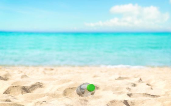 Beach waste water bottles in the sand garbage disposal ecological preservation