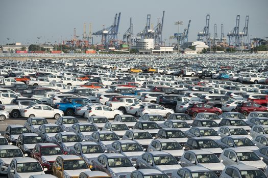 new car lined up in the port for import and export business logistic