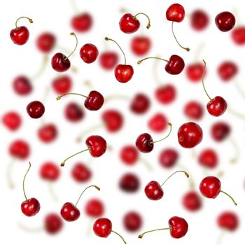 Falling Fresh cherries with stems background. Creative beautiful red ripe cherries summer berries pattern selective focus.