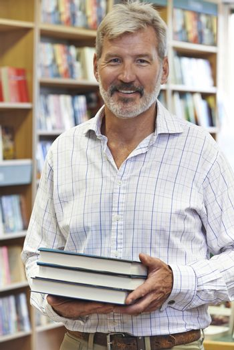 Portrait Of Male Bookshop Owner