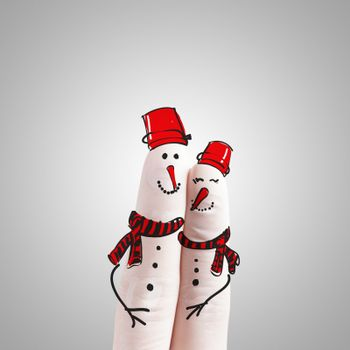 A lovely couple hand drawn and finger as snowmen as concept