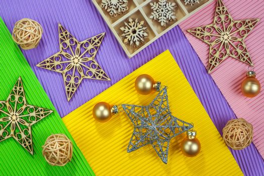 Composition of the Christmas decorations on color paper background. Christmas, winter, New Year concept. Flat lay, top view, copy space. Horizontal shot.