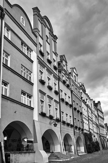 Facades of historic tenement houses with arcades on the market in the city of Jelenia Gora