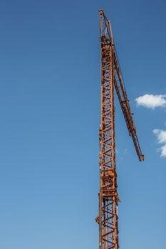 yellow crane on construction site