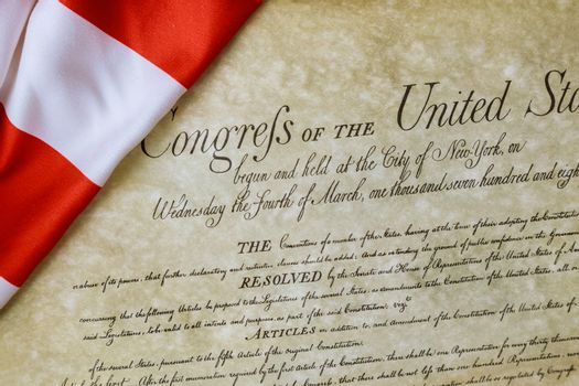 Preamble to the Constitution of the United States of America of closeup of ruffled American flag