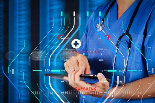 Doctor working on a digital tablet with digital background as co