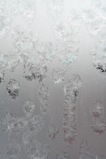Abstract texture, pattern frost on the window, view macro. Shallow dof