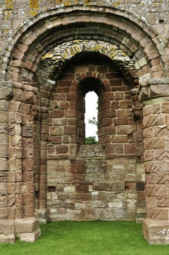 An archway in a ruined stone castle.