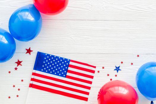 4th July celebration. American flag on white7 backrgound top view.
