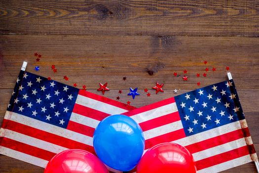 4th July greeting card with American flag and balloons flat lay.