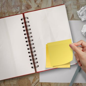 sticky notes with blank open note book on recycle wood desk top