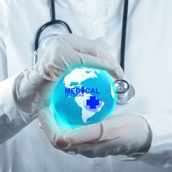 Stethoscope in hand with patient word as medical concept
