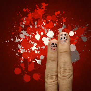 the happy finger couple in love with painted smiley and hold heart as vintage style