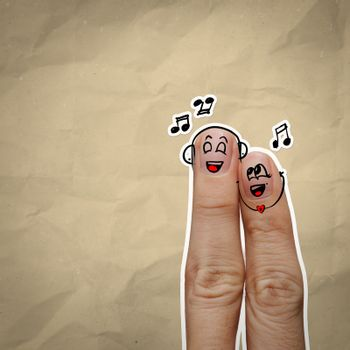 the happy finger couple in love with painted smiley and sing a song on recycle background