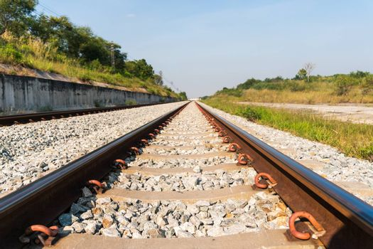 Railroad transportation with blue sky background.